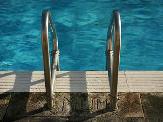 Toddler hospitalized after falling in pool