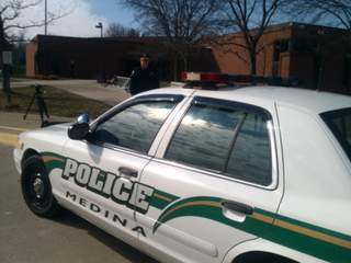 Medina says parent pulled gun in school lot