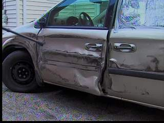 2 hurt when truck hits van on I-77