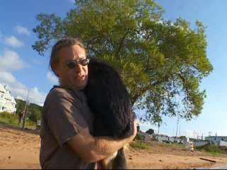 Man swims with sick dog to ease animal's pain