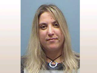 Woman indicted in corruption case