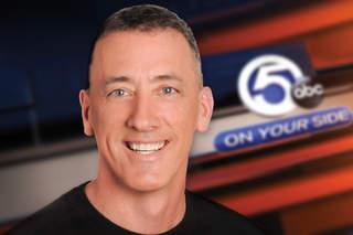 Multimedia journalist Tom Livingston