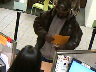 Huntington Bank white bank robber
