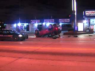 Raw: car flipped on Kinsman