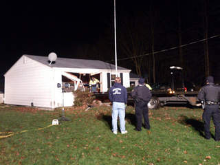 Comanche Trail Mentor car into house