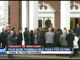 Four more fuenrals planned in Newtown, Conn., as memorial grows