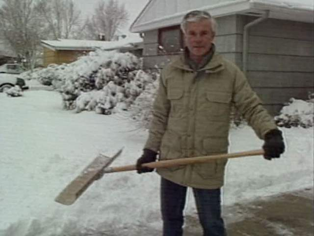 WEWS weatherman shovels contest winner's driveway