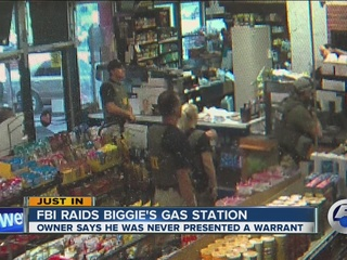 Video fbi raids controversial cleveland store biggie 39 s for Cleveland gas station mural