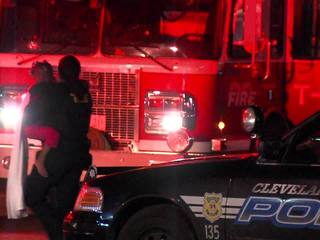 Police help family from burning Cleveland home