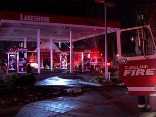 Cleveland firefighters battle a fire inside a gas station for Cleveland gas station mural