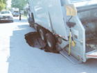 Cleveland garbage truck falls into sink hole