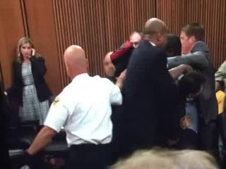 Victim's dad rushes convicted killer in court