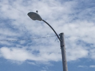 Business owner, councilman want lights fixed