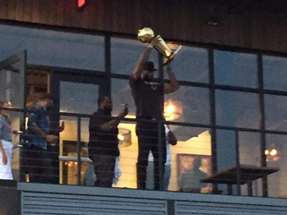 LeBron shows off trophy in the Flats