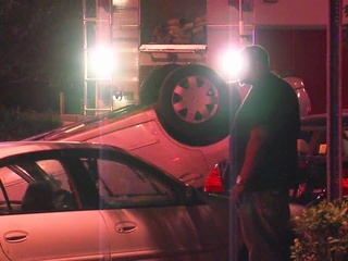 Fight in bar spills into street, causes crash