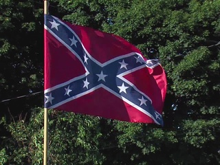 Brick thrown into home flying Confederate flag
