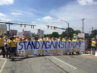 Protesters march across bridge on final RNC day