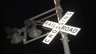 Man hit by train while riding bike, dies