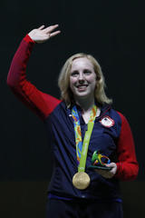 American wins first Olympic gold medal