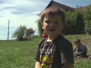 Dad clings to son after boy falls in septic tank