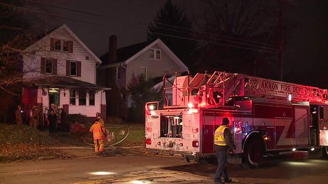 Man says fiancee jumped from attic during Akron house fire