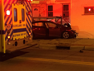 Three injured after car barrels into building