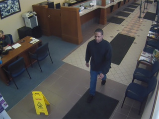 Serial bank robber arrested at city hall