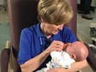 Cuddling babies born to moms addicted to heroin