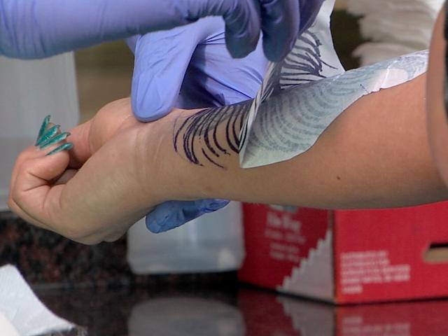 GALLERY: Ohio tattoo artists often work through pain to