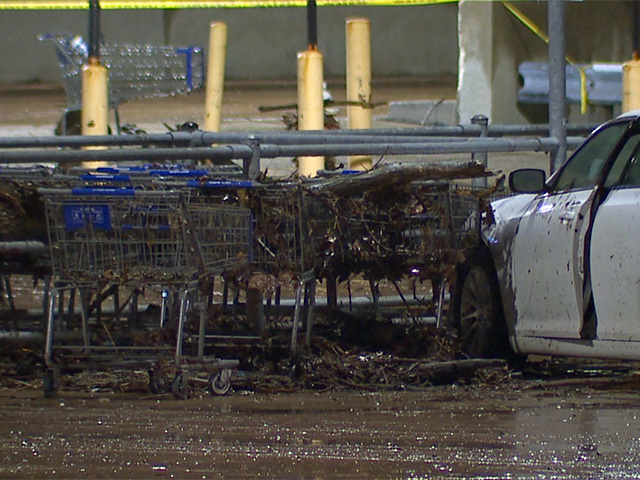 Families rescued by boat from Sam's Club parking lot after heavy ...