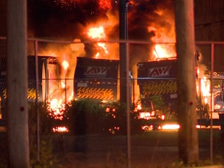Garbage trucks explode into fire overnight