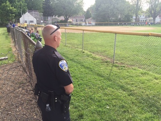 Parents paying for cop at little league games