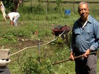 Farmer is knee-deep in soil and in city farming