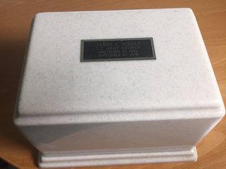 Vet gets proper burial after urn tossed in trash