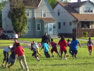 Youth football team kicked off field