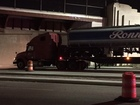 Tanker truck gets stuck under bridge on Shoreway