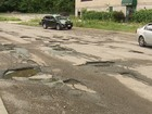 Video: Cars drive on sidewalk to avoid potholes