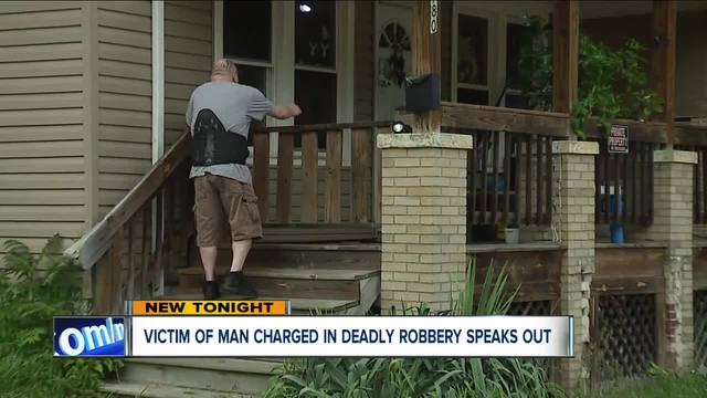 Man robbed by Akron accused murderer speaks out