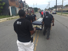 Community marches with caskets to stop violence