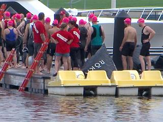 13-year-old boy crosses finish line at triathlon
