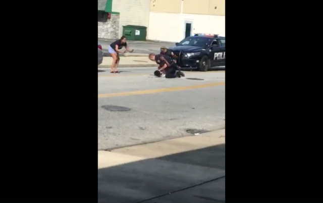 Police arrest video shows OH officer punching resisting suspect