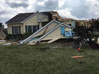 Tornado throws woman and child from home