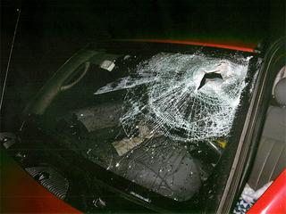 Debris hits windshield, injures driver on I-90