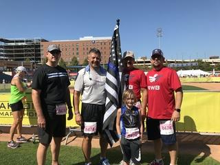 Boy runs Akron Marathon to honor fallen officers