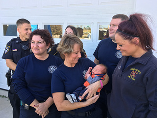 First responders help deliver baby along highway