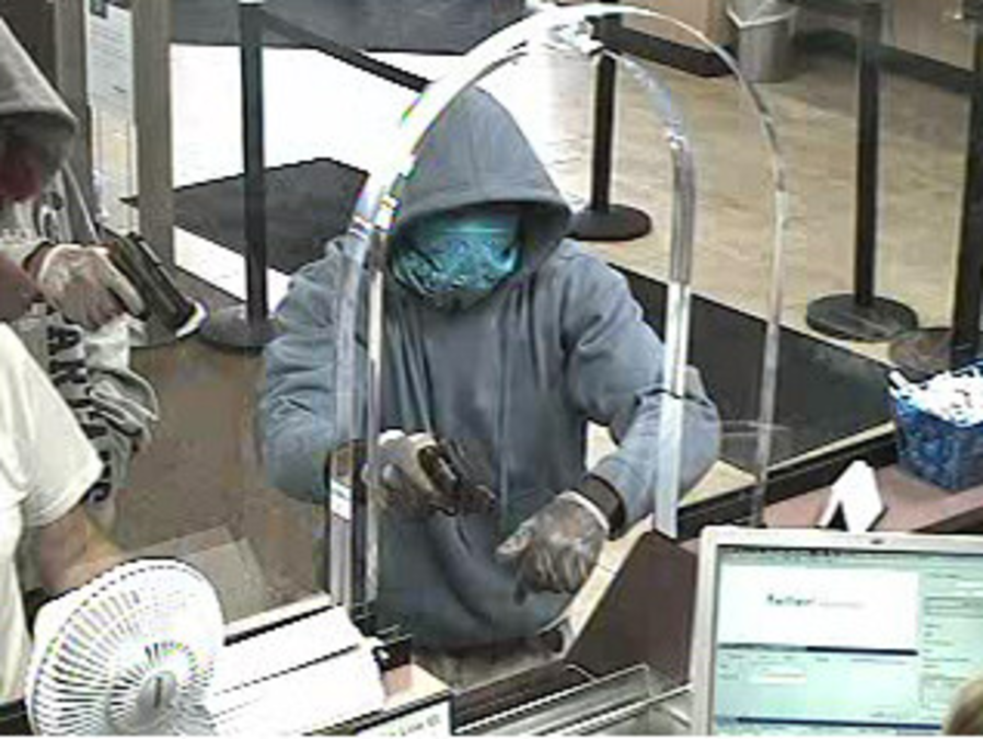 Suspect Fires Gun At Teller During A Botched Chase Bank