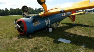 Plane flips over after landing, injures two