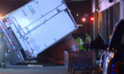 Semi-trailer hauling glass flips over under I-76