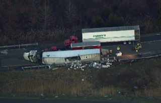 VIDEO: Truck carrying Tito's vodka overturns