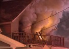 Couple jumps from 2nd floor of burning home